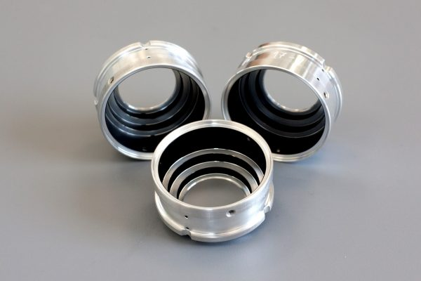 3 circular metallic components coated with fractal black coating from the inside