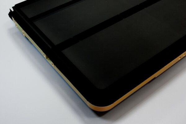 big golden component coated with Acktar's fractal black coating