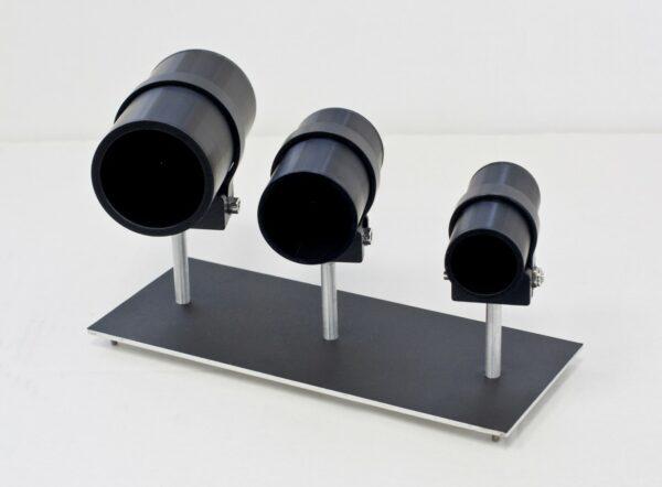3 black coated tube shaped laser beam dumps